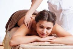 Beautiful young woman getting spa massage Stock Image