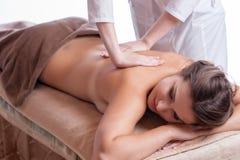 Beautiful young woman getting spa massage Royalty Free Stock Photo