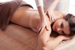 Beautiful young woman getting spa massage Royalty Free Stock Image