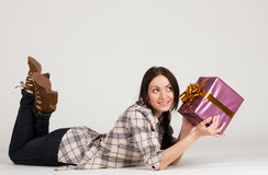Beautiful young woman with a gift box Stock Image