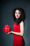 Beautiful young woman with gift box Stock Photography