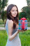 Beautiful young woman with gift box Royalty Free Stock Photo