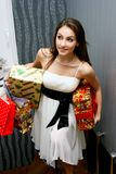 Beautiful young woman with gifts Royalty Free Stock Images