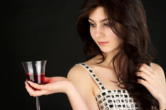 Beautiful young woman with glass Stock Images