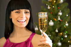 Beautiful young woman with a glass of champagne Royalty Free Stock Images