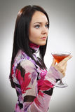 Beautiful young woman with a glass of Martini Royalty Free Stock Photos