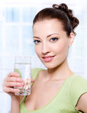 Beautiful young woman with glass of water Royalty Free Stock Image