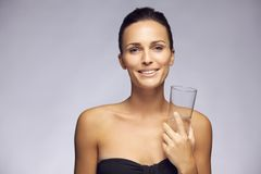 Beautiful young woman with glass of water Royalty Free Stock Images