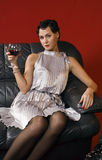 Beautiful young woman with a glass of wine. Royalty Free Stock Image