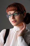 Beautiful young woman in glasses royalty free stock photography