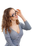 Beautiful young woman with glasses in grey Royalty Free Stock Images