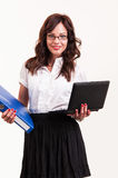 Beautiful young woman with glasses holding laptop and binder Royalty Free Stock Photos