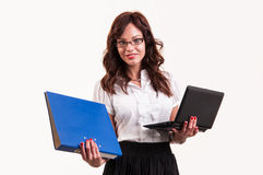 Beautiful young woman with glasses holding laptop and binder Royalty Free Stock Photography