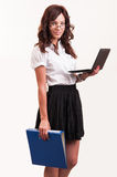 Beautiful young woman with glasses holding laptop and binder Royalty Free Stock Images