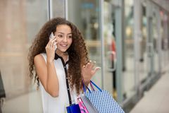 Beautiful young woman goes shopping Stock Photography