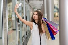 Beautiful young woman goes shopping Stock Photos
