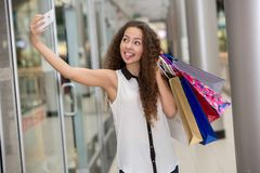 Beautiful young woman goes shopping Stock Image