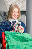Beautiful young woman goes shopping Royalty Free Stock Photography