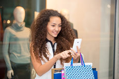 Beautiful young woman goes shopping Royalty Free Stock Image