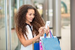 Beautiful young woman goes shopping Royalty Free Stock Images