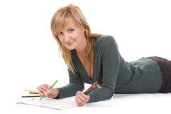 Beautiful young woman is going to draw. Royalty Free Stock Image
