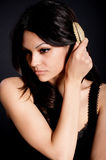 Beautiful young woman with Golden jewelry Royalty Free Stock Images