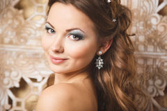 Beautiful young woman in gorgeous blue long dress like Cinderella with perfect make-up and hair style Stock Photography