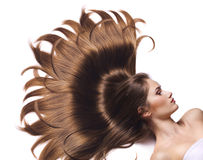 Young woman with beautiful long hair stock photography