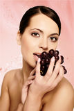 Beautiful young woman with grape Royalty Free Stock Photography