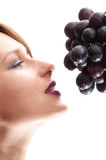 Beautiful young woman with grape Royalty Free Stock Photos