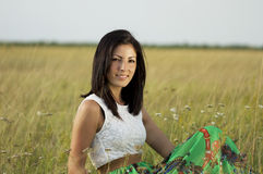 Beautiful young woman in a grass field Royalty Free Stock Image