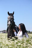 Beautiful young woman and gray horse portrait Royalty Free Stock Images