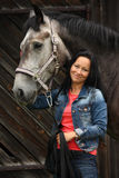 Beautiful young woman and gray horse portrait Stock Photos