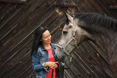 Beautiful young woman and gray horse portrait Stock Images