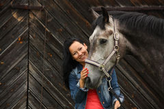 Beautiful young woman and gray horse portrait Stock Image