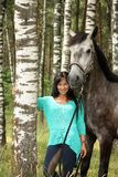 Beautiful young woman and gray horse portrait. In forest Stock Photos