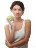 Beautiful young woman with green apple Stock Image