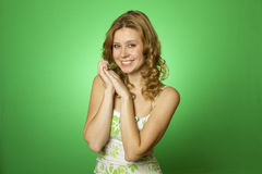 Beautiful young woman on green background Stock Photography