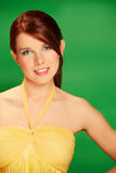 Beautiful young woman on green background royalty free stock photography