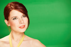 Beautiful young woman on green background royalty free stock photo