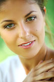 Beautiful young woman on a green background Stock Photo