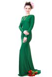 Beautiful young woman in a green evening dress Royalty Free Stock Photography