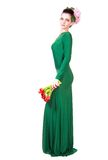 Beautiful young woman in a green evening dress Royalty Free Stock Photos