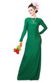 Beautiful young woman in a green evening dress Royalty Free Stock Image