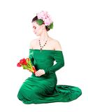 Beautiful young woman in a green evening dress Stock Photos