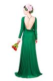 Beautiful young woman in a green evening dress Stock Photography
