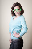 Beautiful young woman with green eyeglasses Stock Images