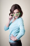 Beautiful young woman with green eyeglasses Stock Photo