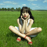 Beautiful young woman on a green field Royalty Free Stock Photos