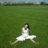 Beautiful young woman on a green field. Portrait of beautifu young woman on a green field Royalty Free Stock Photos